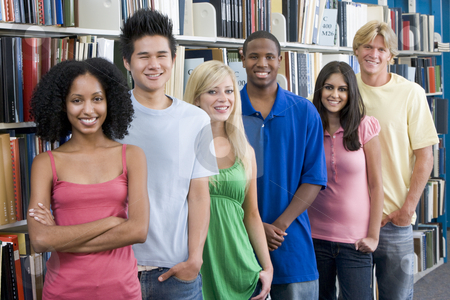 Group of university students in library stock photo, Group of six students standing in front of library bookshelves by Monkey Business Images
