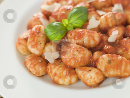 Potato Gnocchi with Tomato Ragu stock photo,  by Monkey Business Images