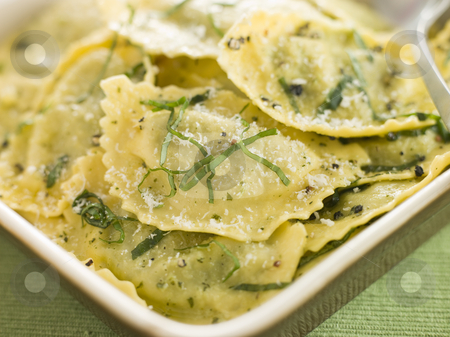 Dish of Spinach and Ricotta Ravioli and Sage Butter stock photo,  by Monkey Business Images