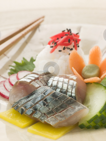 Sashimi of Mackerel with Pickled Daikon Salad and Vinegar Rice stock photo, Plate of Sashimi of Mackerel with Pickled Daikon Salad and Vinegar Rice with chopsticks by Monkey Business Images