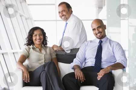 Group of businesspeople in lobby stock photo, Group of businesspeople in office lobby by Monkey Business Images