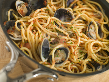 Spaghetti Vongole in a Pan stock photo, Close up of Spaghetti Vongole in a Pan by Monkey Business Images