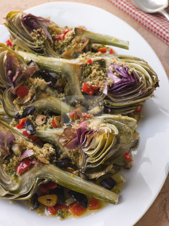 Roasted Globe Artichokes with Aubergine Peppers and Olives stock photo, Plate of Roasted Globe Artichokes with Aubergine Peppers and Olives by Monkey Business Images