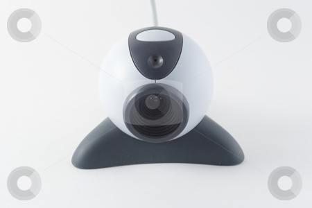 Webcam stock photo, Webcams are video capturing devices connected to computers or computer networks, often using USB or, if they connect to networks, ethernet or Wi-Fi. They are well-known for their low manufacturing costs and flexible applications. by Mariusz Jurgielewicz