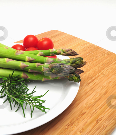 Asparagus, Thyme And Tomatos stock photo, Asparagus spears on a white plate with cherry tomatos and thyme by Lynn Bendickson