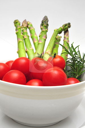 Cherry Tomatos And Asparagus stock photo, Cherry Tomatos and Asparagus in a light colored bowl with thyme by Lynn Bendickson