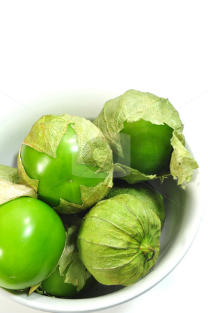 Tomatillo And White Bowl stock photo, Tomatillos with husks on in a small white bowl by Lynn Bendickson