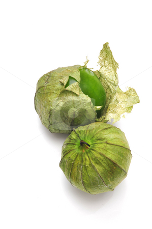 Tomatillo With Husk stock photo, Tomatillos with husks on with one partiall pealed by Lynn Bendickson