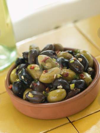 Dish of Mixed Marinated Olives stock photo,  by Monkey Business Images