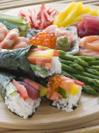 Seafood and Vegetable Hand Rolled Sushi stock photo, Platter of Seafood and Vegetable Hand Rolled Sushi by Monkey Business Images