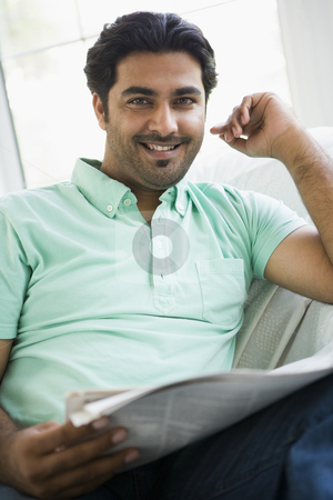 Portrait of a Middle Eastern man reading a newspaper stock photo,  by Monkey Business Images
