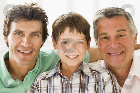 Grandfather with son and grandson smiling stock photo,  by Monkey Business Images