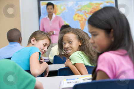 Pupil being bullied in elementary school stock photo, Female pupil being bullied in elementary school by Monkey Business Images