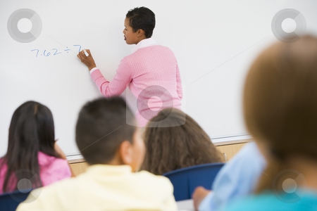 Elementary school maths class stock photo, Elementary school teacher holding maths class by Monkey Business Images