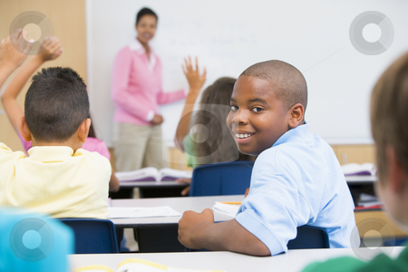 Elementary School Classroom stock photo, Lesson in elementary school classroom by Monkey Business Images