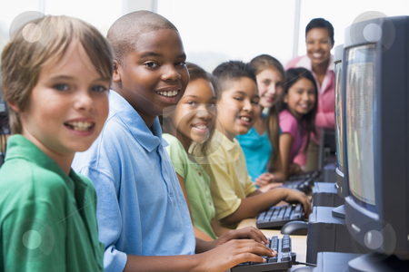 Elementary school computer class stock photo, Elementary school computer class looking to camera by Monkey Business Images