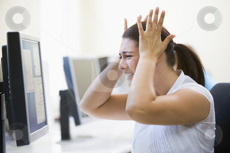 Woman in computer room looking frustrated stock photo,  by Monkey Business Images