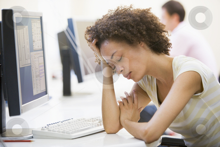 Woman in computer room sleeping stock photo,  by Monkey Business Images