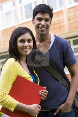 Male and female college students on campus stock photo,  by Monkey Business Images
