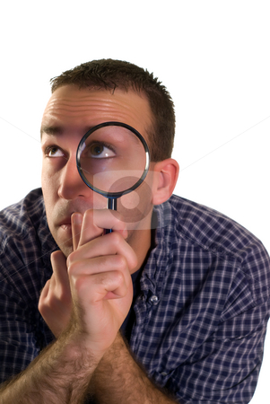 Search And Find stock photo, A young man looking for something with a magnifying glass, isolated against a white background by Richard Nelson