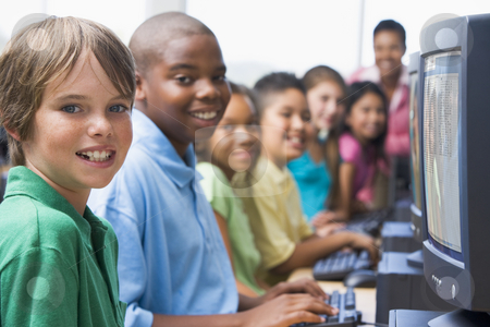 Elementary school computer class stock photo, Elementary school computer class looking at camera by Monkey Business Images