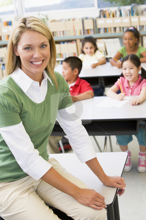 Teacher and students in kindergarten class stock photo,  by Monkey Business Images