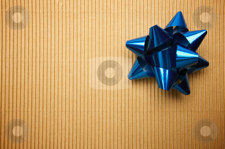 Corrugated Gift Box stock photo, Corrugated Gift Box with a Blue Bow. by Andy Dean