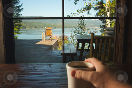 Cup of Coffee and View Of Lake stock photo, Man Holds Cup of Coffee while enjoying View Of Lake by Andy Dean