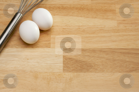 Mixer and Eggs stock photo, Mixer and Eggs on a wooden background. by Andy Dean