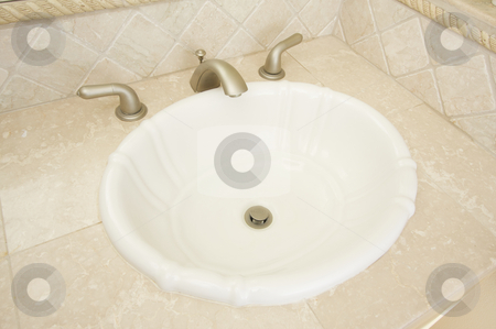 Shell Sink and Faucet  stock photo, Shell Shaped Sink and Faucet and Tile Counter by Andy Dean