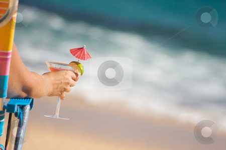 Woman on Beach with Tropical Drink stock photo, Woman Relaxing on Beach with Tropical Drink. by Andy Dean