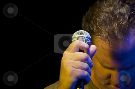 Passionate Vocalist & Microphone stock photo, Passionate Vocalist with Microphone on a black background. by Andy Dean