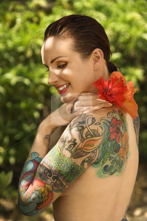 Sexy nude tattooed woman.