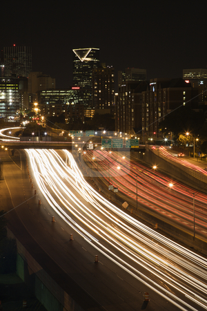 City at night. stock photo, Nightscape of Atlanta, Georgia skyline with blurred automobile lights on highway in foreground. by Iofoto Images