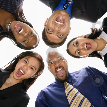 Businesspeople screaming. stock photo, Low angle portrait  of multi-ethnic business group of men and women in huddle screaming. by Iofoto Images