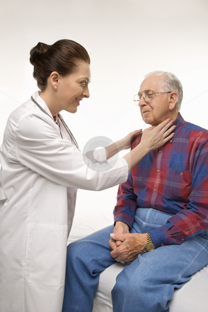 Doctor checking man's pulse. stock photo, Mid-adult Caucasian female doctor checking an elderly Caucasian male's pulse. by Iofoto Images