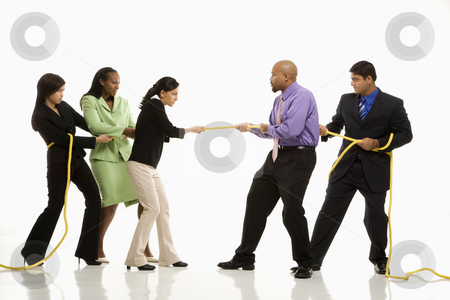 Tug of war. stock photo, Multi-ethnic businessmen  playing tug of war against businesswomen. by Iofoto Images