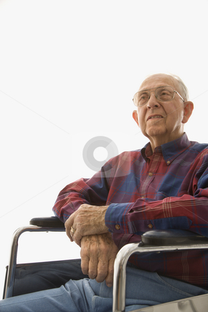 Elderly man in wheelchair. stock photo, Portrait of Caucasion elderly man sitting in wheelchair with hands clasped. by Iofoto Images
