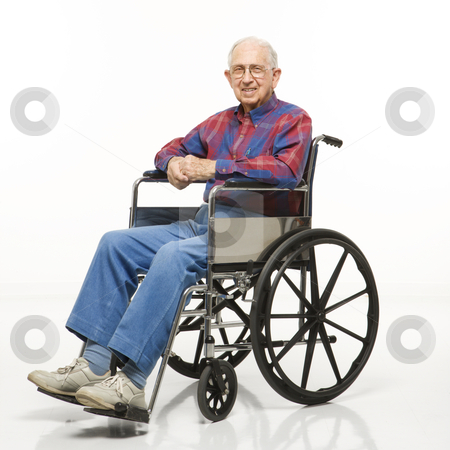 Elderly man in wheelchair. stock photo, Portrait of Caucasion elderly man sitting in wheelchair smiling at viewer. by Iofoto Images