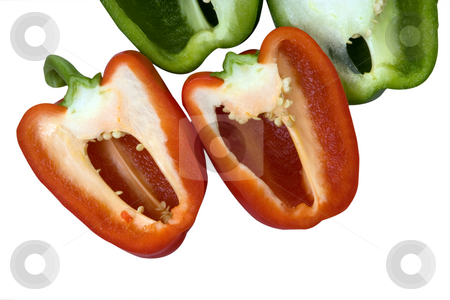 Red and green stock photo, Red and green peppers sliced in half by Paul Phillips