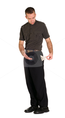 Bankruptcy stock photo, A man going into bankruptcy holding out an empty pocket by Richard Nelson