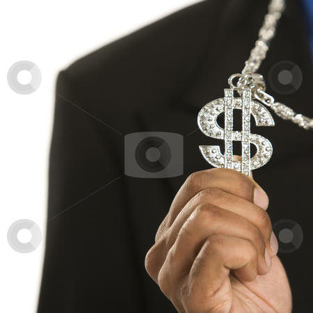 Man wearing money sign. stock photo, African American man wearing necklace with money sign. by Iofoto Images