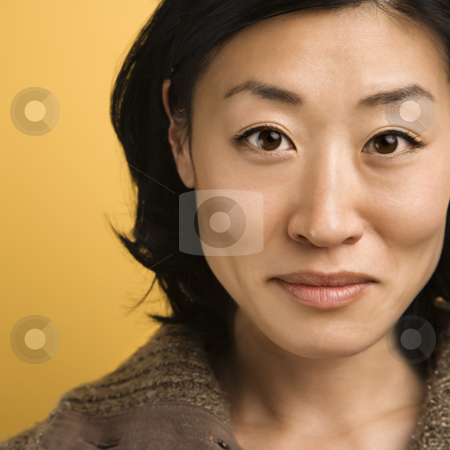 Portrait of woman. stock photo, Close up portrait of mid adult Asian woman. by Iofoto Images