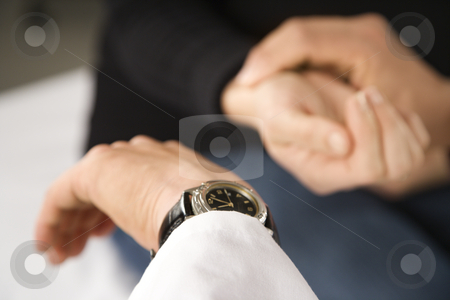 Doctor taking patient's pulse. stock photo, Doctor taking patient's pulse. by Iofoto Images
