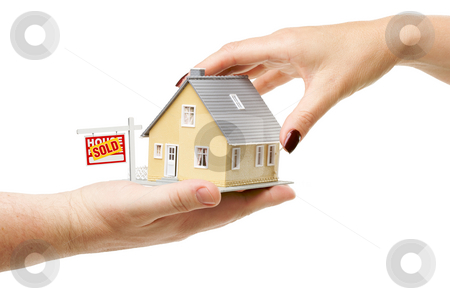 Reaching For A Home with Sold Real Estate Sign stock photo, Reaching For A Home with Sold Real Estate Sign Isolated on a White Background. by Andy Dean