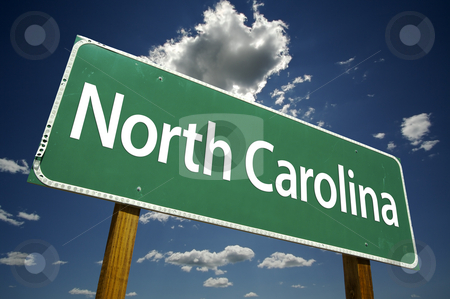 North Carolina Road Sign stock photo, North Carolina Road Sign with dramatic clouds and sky. by Andy Dean