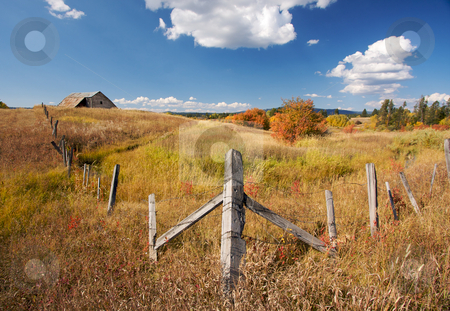 Beautiful Fall Landscape stock photo, Beautiful Fall Landscape with Rustic Barn, Fence and Clouds by Andy Dean