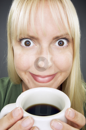 Beautiful Woman Enjoys Coffee stock photo, Beautiful Woman Enjoys Her Coffee Against a Grey Background. by Andy Dean