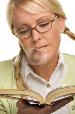 Female With Ponytails Reads Her Book stock photo, Female With Ponytails Reads Her Book isolated on a White Background. by Andy Dean
