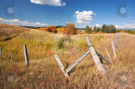 Beautiful Fall Landscape with Rustic Fence stock photo, Beautiful Fall Landscape with Rustic Fence and Clouds by Andy Dean